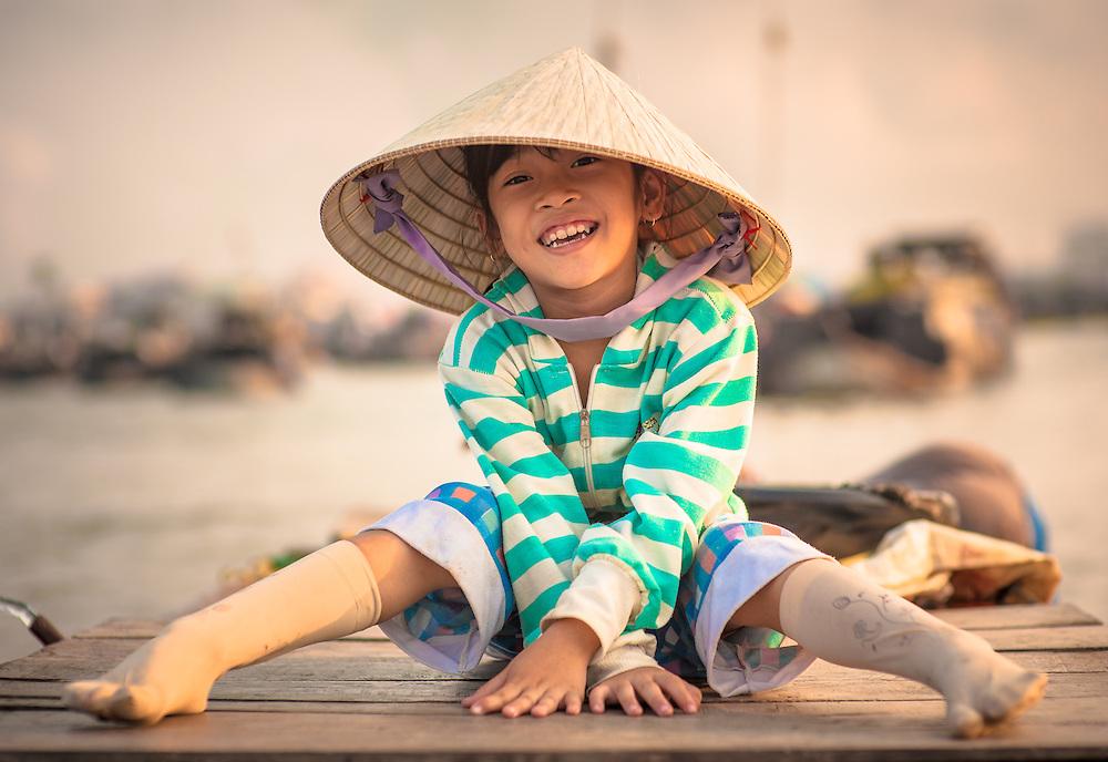 Vietnamese girl on boat on Mekong river (Vietnam)