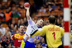 Luka Zvizej of Slovenia vs Jose Javier Hombrados of Spain during handball match between Spain and Slovenia in  Main Round of 10th EHF European Handball Championship Serbia 2012, on January 25, 2012 in Spens Hall, Novi Sad, Serbia. Spain defeated Slovenia 35-32. (Photo By Vid Ponikvar / Sportida.com)