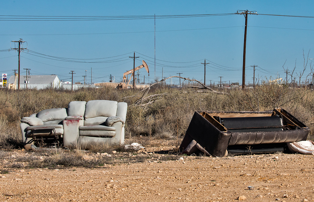 Discarding couches in Pecos Texas in the Permain Basin.