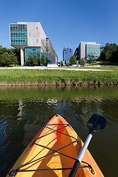 View from kayak on the Trinity River to the Tarrant County College Trinity River Campus East  and the nearby Trinity Trails, Fort Worth, Texas, USA.