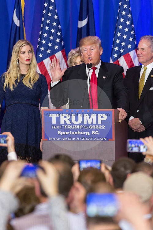 Billionaire and GOP presidential candidate Donald Trump addresses supporters alongside daughter Ivanka and Lt. Gov. Henry McMasters as they celebrate victory in the South Carolina Republican primary February 20, 2016 in Spartanburg, South Carolina, USA .