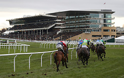 Runners take the bend in the Caspian Caviar Gold Cup Handicap Steeple Chase during day two of The International meeting at Cheltenham Racecourse