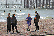 April 6, 2020, London, England, United Kingdom: People walk on the beach in Brighton, Britain on Monday, April 6, 2020 - as British Prime Minister Boris Johnson was moved to intensive care after his coronavirus symptoms worsened in London. Johnson was admitted to St Thomas' hospital in central London on Sunday after his coronavirus symptoms persisted for 10 days. Having been in hospital for tests and observation, his doctors advised that he be admitted to intensive care on Monday evening. The new coronavirus causes mild or moderate symptoms for most people, but for some, especially older adults and people with existing health problems, it can cause more severe illness or death. (Credit Image: © Vedat Xhymshiti/ZUMA Wire)