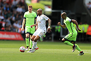 Andre Ayew of Swansea city breaks away from Fernandinho of Manchester city.Barclays Premier league match, Swansea city v Manchester city at the Liberty Stadium in Swansea, South Wales on Sunday 15th May 2016.<br /> pic by Andrew Orchard, Andrew Orchard sports photography.