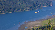 Barge sailing down the Columbia River through the Gorge.