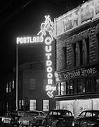 Y-540326-01. Night view of Portland Outdoor Store. SW 3rd & Oak. March 26, 1954.