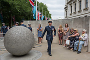 On the 100th anniversary of the Royal Air Force RAF and following a flypast of 100 aircraft formations representing Britains air defence history which flew over central London, a serviceman leaves Horseguards, passing the memorial to those killed in the 2002 Bali bombing, on 10th July 2018, in London, England.