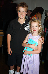 JACK BURKE and his sister ELEANOR BURKE at a party to celebrate the publication of The Man Who Fell in Love With His Wife by Paul Burke held at The Groucho Club, 45 Dean Street, London W1 on 12th July 2004.