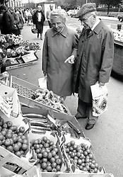 Elderly couple shopping in Nottingham, UK 1989