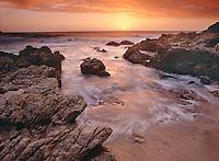 Sunset among the rocks of Big Sur coast.