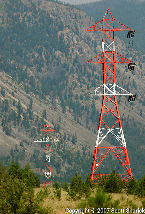 Power lines strung along red and white towers. Missoula Photographer, Missoula Photographers, Montana Pictures, Montana Photos, Photos of Montana