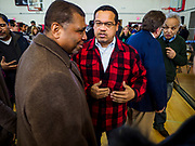 16 MARCH 2019 - BLOOMINGTON, MINNESOTA, USA: KEITH ELLISON, Minnesota Attorney General, right, talks to a constituent at Dar al Farooq Center in Bloomington. An interdenominational crowd of about 1,000 people came to the center to protest white supremacy and religious intolerance and to support Muslims in New Zealand who were massacred by a white supremacist Friday. The Twin Cities has a large Muslim community following decades of Somali immigration to Minnesota. There are about 45,000 people of Somali descent in the Twin Cities.    PHOTO BY JACK KURTZ