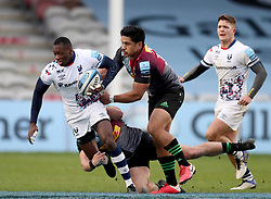 Niyi Adeolokun of Bristol Bears is tackled by James Lang and Ben Tapuai of Harlequins - Mandatory by-line: Matt Impey/JMP - 26/12/2020 - RUGBY - Twickenham Stoop - London, England - Harlequins v Bristol Bears - Gallagher Premiership Rugby
