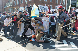 """Neo-Nazis, white supremacists and other alt-right factions scuffled with counter-demonstrators near Emancipation Park (Formerly """"Lee Park"""") in downtown Charlottesville, Virginia. After fighting between factions escalated, Virginia State Police ordered the evacuation by all parties and cancellation of the """"Unite The Right"""" rally scheduled to take place in the park. (Photo by Albin Lohr-Jones/Pacific Press) *** Please Use Credit from Credit Field ***"""