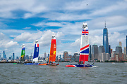Four SailGP F50s on moorings alongside Ellis Island before racing. Race Day 1 Event 3 Season 1 SailGP event in New York City, New York, United States. 21 June 2019. Photo: Chris Cameron for SailGP. Handout image supplied by SailGP