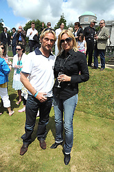 CARL FOGARTY and his wife MICHAELA at the Cartier Style et Luxe, the Goodwood Festival of Speed, West Sussex on 13th July 2008.<br /> <br /> NON EXCLUSIVE - WORLD RIGHTS