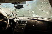 A bullet splattered windshield on a vehicle held for evidence from a drug assignations at the Juarez City Forensic Lab in Juarez, Mexico January 16, 2009.  An ongoing drug war has already claimed more than 40 people since the start of the year. More than 1600 people were killed in Juarez in 2008, making Juarez the most violent city in Mexico.    (Photo by Richard Ellis)