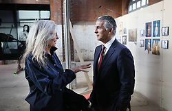 © Licensed to London News Pictures. This image is free to use ONLY in connection with the launch of the 'WOMEN: New Portraits' exhibition. 13/1/2016. London, UK. Annie Leibovitz talks with Sergio P Ermotti, Group CEO, UBS at the launch of the 'WOMEN:New Portraits' exhibition at Wapping Hydraulic Power Station. The exhibition opens to the public from Saturday 16th January until 7th February 2016. The newly commissioned photographs by the world renowned photographer will travel to 10 cities over the course of twelve months – London, Tokyo, San Francisco, Singapore, Hong Kong, Mexico City, Istanbul, Frankfurt, New York and Zurich. Access will be free to the public. Photo credit: Peter Macdiarmid/LNP