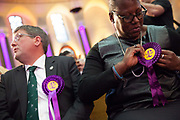 UKIP, The UK Indepenence Party, campaigns as an anti racist party whilst against immigration and the EU. The front rows of the hall are filled with multi ethnic supporters to reinforce the message.