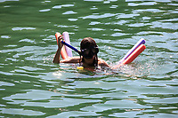 young girl with snorckle, mask and floater in ilha grande of state of rio de janeiro in angra dos reis in brazil