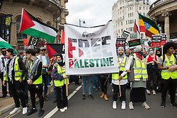 London, UK. 26th June, 2021. Pro-Palestinian activists from the Muslim Association of Britain join thousands of people attending a United Against The Tories national demonstration organised by the People's Assembly Against Austerity in protest against the policies of Prime Minister Boris Johnson's Conservative government. The demonstration contained blocs from organisations and groups including Palestine Solidarity Campaign, Stand Up To Racism, Stop The War Coalition, Extinction Rebellion, Kill The Bill and Black Lives Matter as well as from trade unions Unite and the CWU.