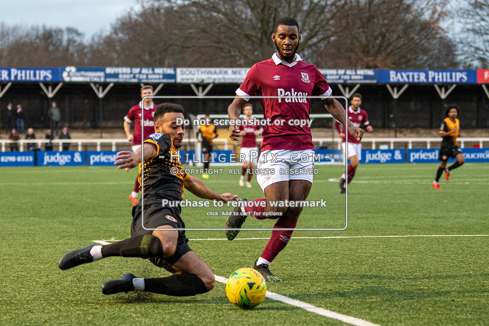 BROMLEY, UK - DECEMBER 07: Jerome Federico, of Cray Wanderers FC, slides in to cross the ball during the BetVictor Isthmian Premier League match between Cray Wanderers and Potters Bar Town at Hayes Lane on December 7, 2019 in Bromley, UK. <br /> (Photo: Jon Hilliger)