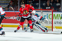 KELOWNA, CANADA - MARCH 3: Josh Paterson #17 of the Portland Winterhawks looks for the pass ahead of Roman Basran #30 of the Kelowna Rockets on March 3, 2019 at Prospera Place in Kelowna, British Columbia, Canada.  (Photo by Marissa Baecker/Shoot the Breeze)