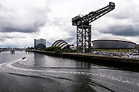 A boat zigzags it's way past famous Glasgow landmarks including the Finnieston Creane