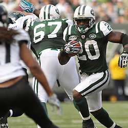 Nov 15, 2009; East Rutherford, NJ, USA; New York Jets running back Thomas Jones (20) rushes the football during first half NFL action between the New York Jets and Jacksonville Jaguars at Giants Stadium.