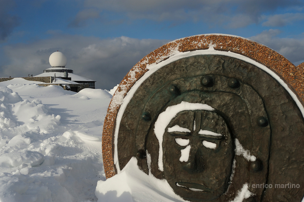 Children Of The Earth monument on North Cape. North Cape is a cape on the island of Magerøya in northern Norway, in the municipality of Nordkapp. Its 307 m high, steep cliff is often referred to as the northernmost point of Europe, located at 71°10′21″N, 2102.3 km from the North Pole.