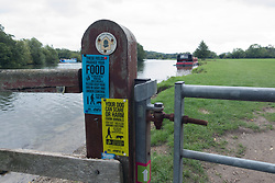 Thames Path National Trail where it runs between Pangbourne and Purley near Reading. Cows are normally grazing the field shown so warning signs to dog owners. UK 2020