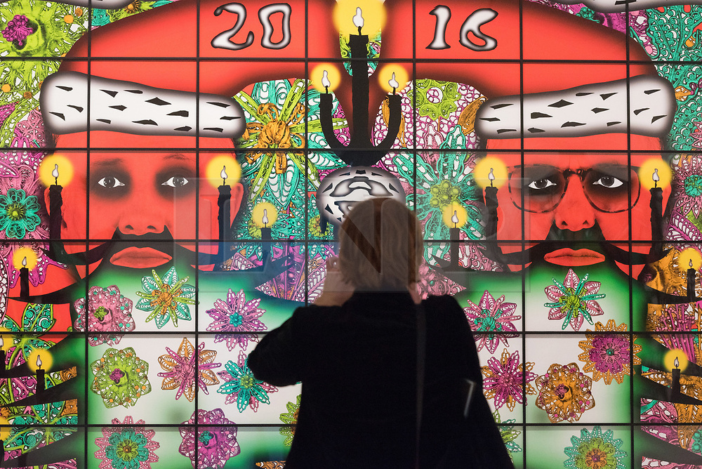 © Licensed to London News Pictures. 21/11/2017. London, UK. A visitor views artwork titled Beardmas by artists GEORGE PASSMORE and GILBERT PROUSCH otherwise known as GILBERT and GEORGE. The work is showing at the exhibition The Beard Pictures and Their Fuckosophy at the White Cube gallery. Photo credit: Ray Tang/LNP