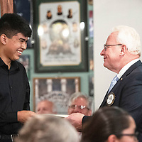 Nathaniel Milford, a St. Michaels High School graduating senior is presented with a Rotary scholarship for $1000 from Jay McCollum, the Rotary Club's Senior of the Year Chairman for the 2018-2019 school year, Wednesday, May 1 at the Senior of the Year luncheon at Sammy C's in Gallup.