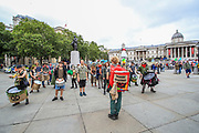 The XR Drummers crew are warming up for their performance on the first day of the environmental activist group Extinction Rebellion (XR) protest in Trafalgar Square, central London on Monday, Aug 23, 2021 - as the movement launched a two-week protest campaign to demand that the government take greater action to address climate change. (VX Photo/ Vudi Xhymshiti)