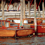 Motor boats moored on a canal in Venice, Italy