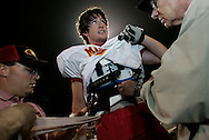 Senior offensive lineman Rich Annett gets his cracked ribs re-wrapped by team trainer Mike Fleming, left, and Dr. Mark Legome during Mission Viejo's 62-0 victory over Capo Valley Friday October 21, 2005.