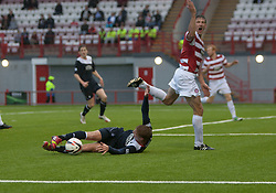 Falkirk's Jay Fulton goes down in the box after the tackle from Hamilton's Martin Canning, and gets a yellow card for diving.<br /> Hamilton 2 v 0 Falkirk, Scottish Championship played today at New Douglas Park.<br /> ©Michael Schofield.