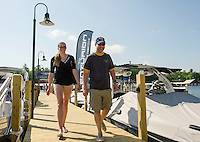 The docks are lined with boats for visitors joining in the Naswa Resorts's Naz Aqua Mania this weekend.   (Karen Bobotas/for the Laconia Daily Sun)