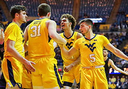 Mar 20, 2019; Morgantown, WV, USA; West Virginia Mountaineers teammates celebrate with West Virginia Mountaineers forward Logan Routt (31) during the first half against the Grand Canyon Antelopes at WVU Coliseum. Mandatory Credit: Ben Queen