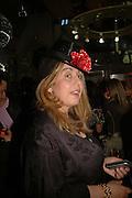 Roberta Resta, MILLA JOVOVICH, CARMEN HAWK & HARVEY NICHOLS CELEBRATE THE LAUNCH OF JOVOVICH-HAWK. FIFTH FLOOR CAFƒ. HARVEY NICHOLS. london.  27 April 2006. ONE TIME USE ONLY - DO NOT ARCHIVE  © Copyright Photograph by Dafydd Jones 66 Stockwell Park Rd. London SW9 0DA Tel 020 7733 0108 www.dafjones.com