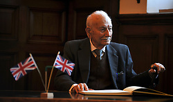 """© Licensed to London News Pictures. 02/02/2012, Kingston Upon Thames, UK. 104 year-old becomes Britain's oldest new citizen. 104 year-old TAUFEEK KHANJAR became a British Citizen at a ceremony held by Surrey County Council today (01 February 2012). Mr Khanjar is originally from Iraq and worked as a jewellery maker in Baghdad. He came to the UK six years ago to live with his daughter Nada Dabis, 59, in South Cheam, Surrey, where he enjoys walking, feeding the birds, playing cards and listening to music. He is a widower with four sons and two daughters. Durning the ceremony Mr Khanjar took an oath to the Queen, pledging that he will be a faithful citizen and obey the laws of the country. He explained the secret to a long and healthy life was to """"never get stressed and be relaxed"""".  Photo credit : Stephen Simpson/LNP"""