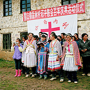 Wearing their traditional costumes, Miao and Yi women sing hymns at Qie Chong village's 100 years anniversary of the Catholic church celebration, Guizhou province, China.
