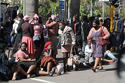 South Africa - Durban - 12 August 2020 - People in Durban CBD sitting in groups or walking in numbers, some not wearing their masks, ignoring lockdown regulations to keep a maximum distance apart<br /> Picture: Doctor Ngcobo/African News Agency(ANA)