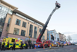 © Licensed to London News Pictures; 16/04/2020; Bristol, UK. A fire engine turntable ladder is extended and members of the emergency services and the public clap at 8pm on Thursday evening outside the Bristol Royal Infirmary hospital to applaud NHS health service workers during the coronavirus Covid-19 pandemic. Today the UK recorded another 861 coronavirus deaths in hospital, taking the total to 13,729, with a total of 103,093 people who have tested positive for the virus. There is a UK wide lockdown with the biggest restrictions on freedom of movement ever imposed in the UK. Photo credit: Simon Chapman/LNP.