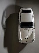 Image of a white 1968 Porsche 911S raced by Davey Jordan with Vasek Polak, Santa Cruz, California, America west coast by Randy Wells