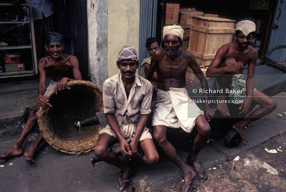 A portrait of street market traders, on 16th April 1980, in Colombo, Sri Lanka.