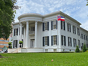 Pictured is the Mississippi State Capitol  still flying the Mississippi flag with the Confederate emblem on it, just hours before Governor Tate Reeves signed a historic Bill HB1796 decommissioning the state flag and opening the door to a new flag without the Confederate emblem that has flown for 126 years.<br /> <br /> A Mississippi flag flies at the governors mansion in Jackson, Mississippi, U.S., June 30, 2020.  REUTERS/Suzi Altman