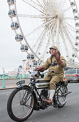 © Licensed to London News Pictures. 20/03/2016. Brighton, UK. A man dressed in period clothing drives a vintage bike to Brighton on the fist day of Spring. Photo credit: Hugo Michiels/LNP