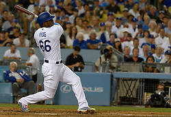 June 21, 2017 - Los Angeles, California, U.S. - Los Angeles Dodgers' Yasiel Puig hits three run home run against the New York Mets in the fourth inning of a Major League baseball game at Dodger Stadium on Wednesday, June 21, 2017 in Los Angeles. Los Angeles. (Photo by Keith Birmingham, Pasadena Star-News/SCNG) (Credit Image: © San Gabriel Valley Tribune via ZUMA Wire)
