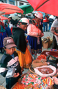 ECUADOR, HIGHLANDS, CANAR Canari Indians in outdoor market